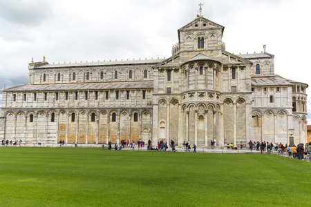 PISA, ITALY - MAY 13, 2019: View on Pisa Cathedral, sunny day, Piazza del Duomo, crowds of tourists