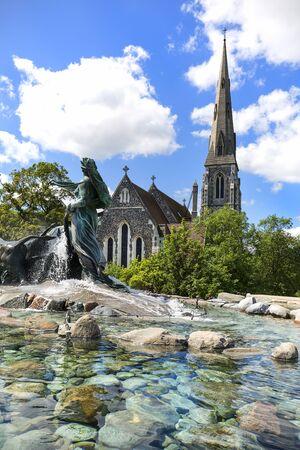 COPENHAGEN, DENMARK - JUNE 22, 2019 :  St. Alban Church and Gefion Fountain located in port in Nordre Toldbod area next to Kastellet Stock Photo