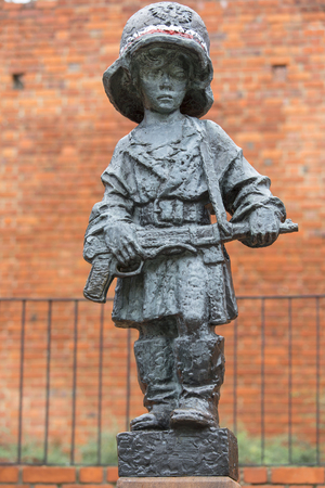 WARSAW, POLAND -OCTOBER 17, 2019 : Symbolic monument of the Little Insurrectionist, a child hero fighting in the Warsaw Uprising 1944