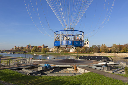 KRAKOW, POLAND - OCTOBER 21, 2019: Observation balloon with a basket for people, located near Wawel to view the Old Town from the top and the bend of the Vistula River
