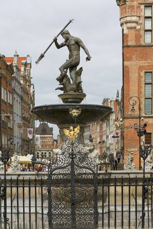 GDANSK, POLAND - JUNE 5, 2018: 17th century Neptune's Fountain Statue at Long Market Street next to Main Town Hall
