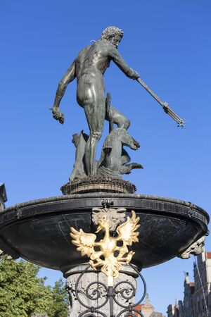 GDANSK, POLAND - JUNE 5, 2018: 17th century Neptune's Fountain Statue at Long Market Street next to Main Town Hall Stockfoto