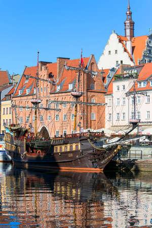 Gdansk,Poland - June 6, 2018: Long Embankment street; boulevards on the Motlawa River; port for tourist ships, wooden galleon Editorial