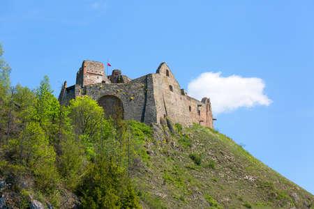 Niedzica, Poland - May 18, 2020: 14th century Czorsztyn Castle, ruins of medieval fortress at Lake Czorsztyn within Pieniny National Park borders