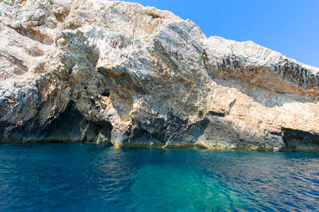 Blue Cave carved in the limestone by the Adriatic Sea, view from the water, Bisevo Island, Croatia