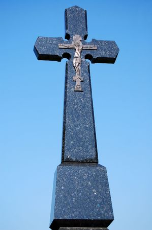 stone cross wirh Jesus image photo