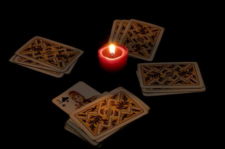chiromancy: playing cards on black background