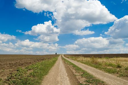 a dirt road is directed in clouds Stock Photo - 3443143