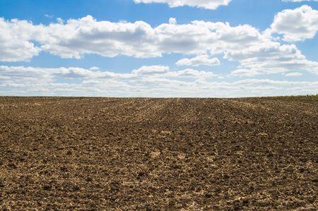 arable: arable soil at autumn under blue sky Stock Photo