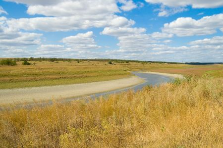 river in steppe with clouds in the sky Stock Photo - 3539443