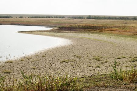 rainless: drying out lake with a cracked bank