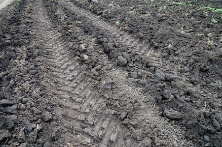 tractor road on tilliage photo