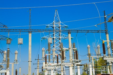 big power transmission pole on blue photo