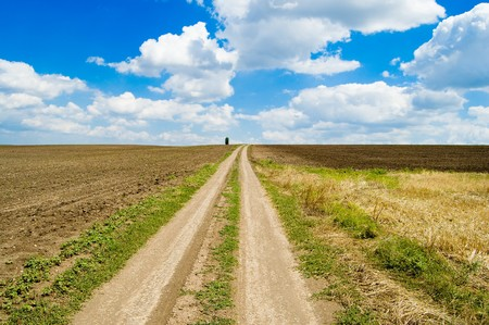 a dirt road is directed in clouds Stock Photo - 4321657