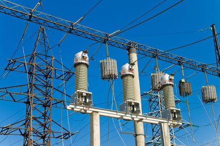 high-voltage substation on blue sky background photo