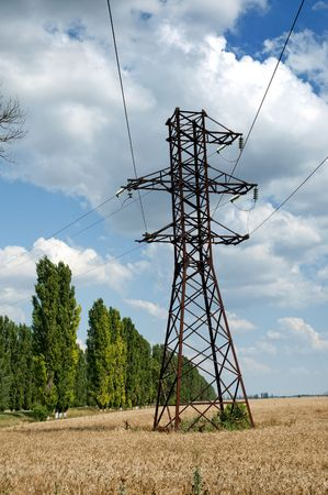 power transmission tower on field photo