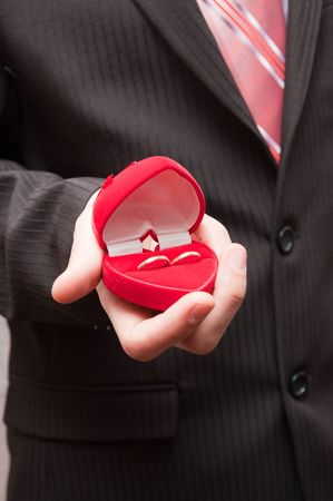 man offers two rings Stock Photo - 6475156