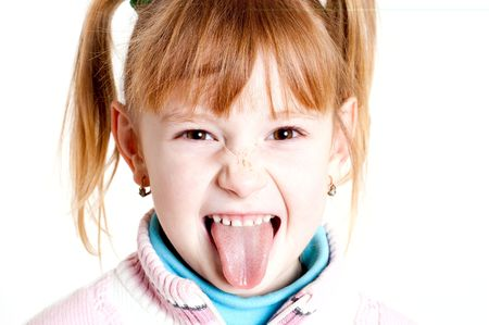 girl tongue: portrait of a young girl puting out her tongue
