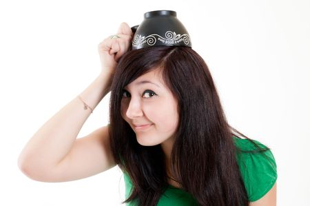 young beautiful girl with cup over head Stock Photo - 6679498