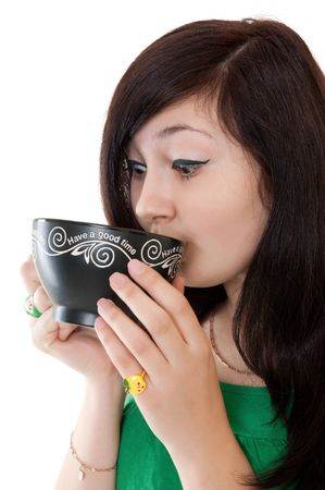 drinking girl with cup of tea photo