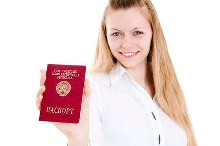 beautiful girl showing her passport of USSR (focus on the passport) photo