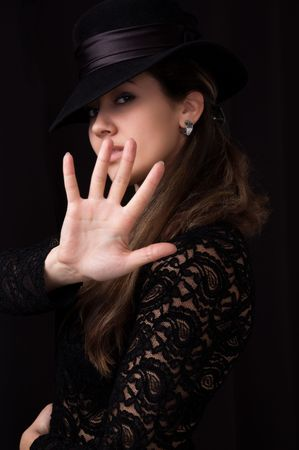 women in black hat showing stop Stock Photo - 6801989