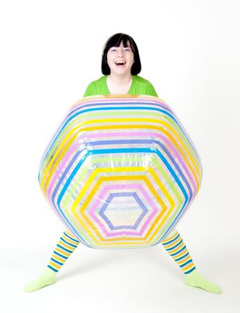 smiling girl with big ball in studio photo