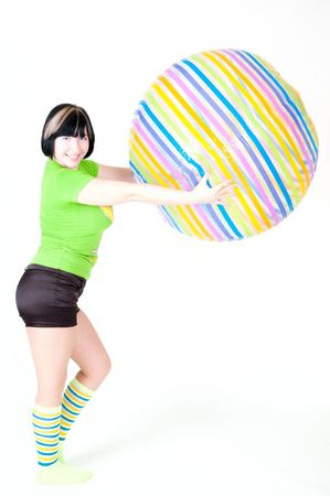 young woman exercising with gym ball photo