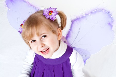 little girl likes violet butterfly Stock Photo - 6970508