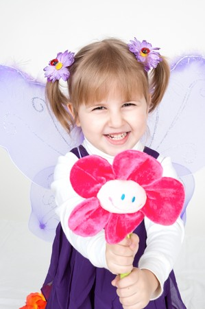 flower show: smiling child offers a flower