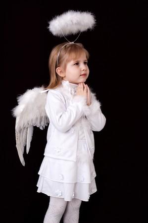 praying little angel over black photo