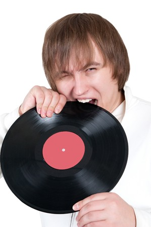 sound bite: a boy bites a vinyl plate Stock Photo