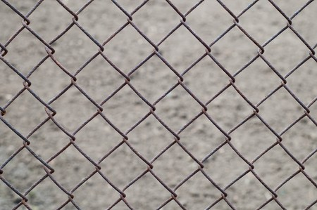 rusty wire netting as background over earth Stock Photo - 6987326