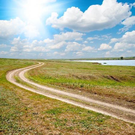 dirty way to horizon under sun and clouds Stock Photo - 7118017