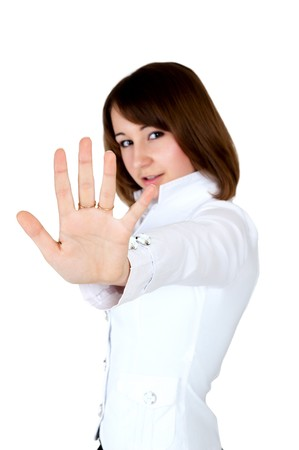 women in white showing stop. hand in focus photo