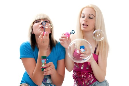 shot of a pretty teen girls blowing bubbles photo