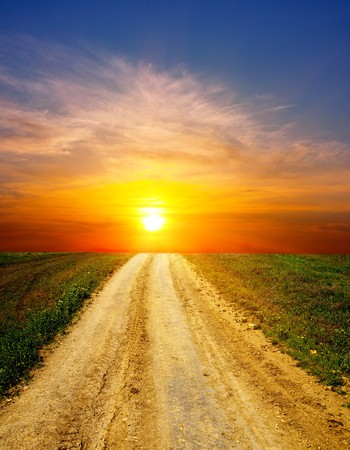 sunset over rural road photo