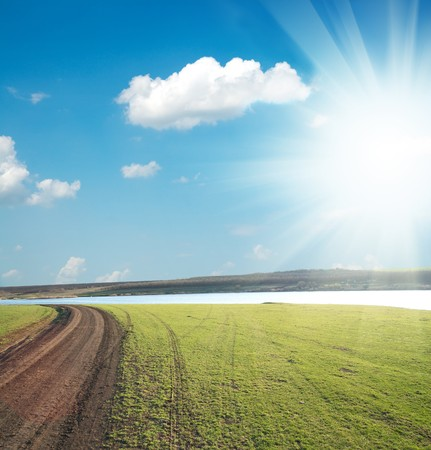 dirty way to horizon under sun and clouds Stock Photo - 7558964
