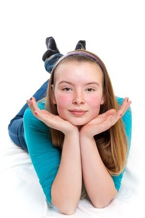 teenage girl laying on floor photo