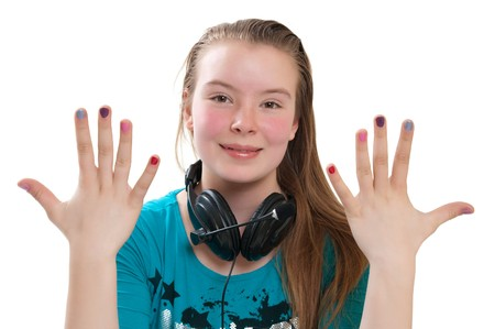 teenager with headphones showing manicure photo