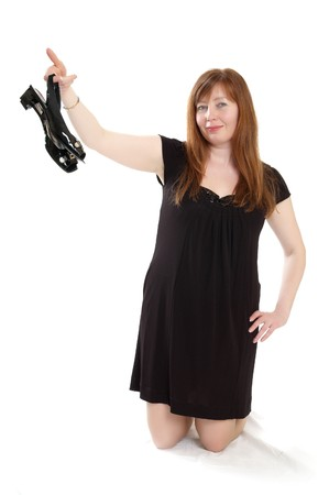 woman in black dress with shoes in hand Stock Photo - 7629048