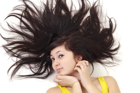 beautiful young woman lying on white with scatter hair photo