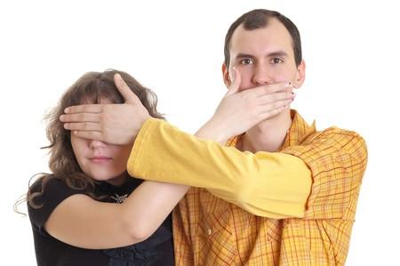closes eyes: boy closes eyes girl and girl closes mouth to boy Stock Photo