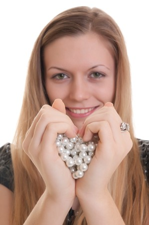 young beautiful girl showing heart symbol. soft focus on hands Stock Photo - 7804345