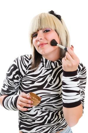 girl applying make up photo
