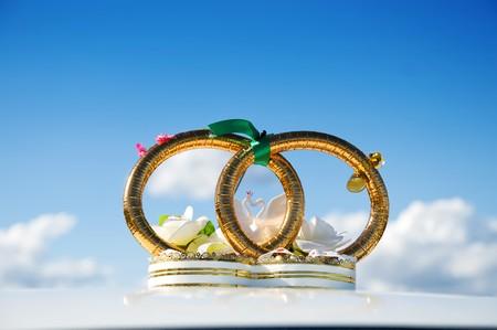 golden weddings rings over car Stock Photo - 8037493