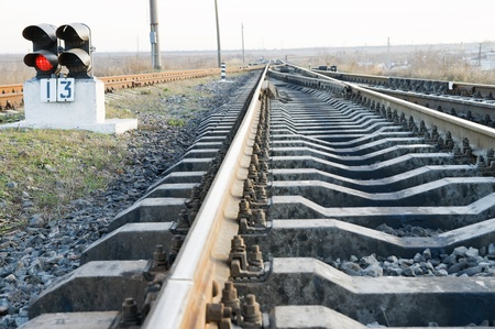 railway with stop signal lamp photo