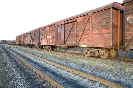 old rusty train wagons on railway photo