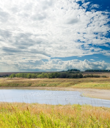 cloudy landscape with river Stock Photo - 8525288