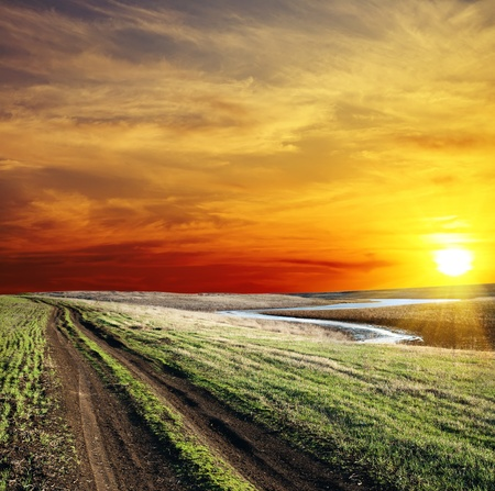 rural road near river and nice sunset Stock Photo - 8764516